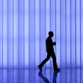 lone male worker at night in an office with tracking device from Realtime Location